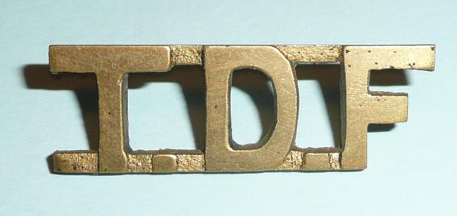 WW2 East Africa  - TDF Tanganyika Defence Force Cast Brass Shoulder Title